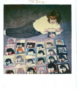 Nick Rhodes on the floor of his suite in a West Hollywood Hotel judging the entries in the Nick Rhodes coloring contest in Star Hits. It took him HOURS to decide.